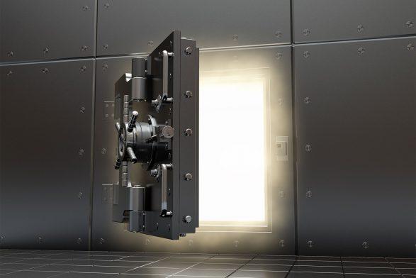 dark bank door opening to reveal light